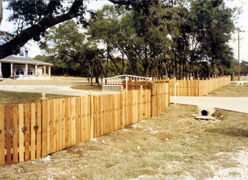 2 rail 4 foot spaced wood picket property fence