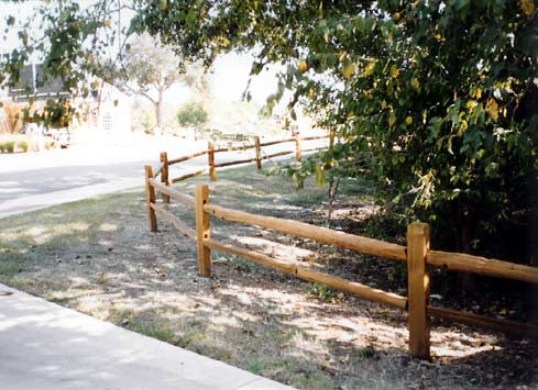 2 rail split cedar fence with posts around driveway