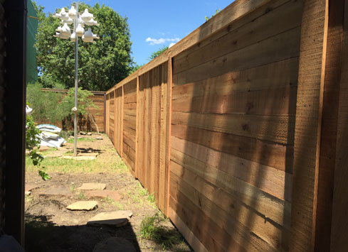 alternating vertical and horizontal picket cedar fence