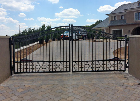 automatic driveway gate made of wrought iron