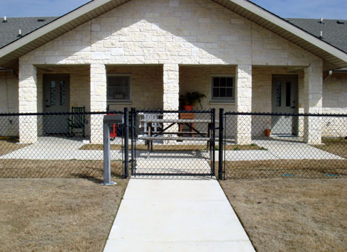 black chain link fence with gate to home