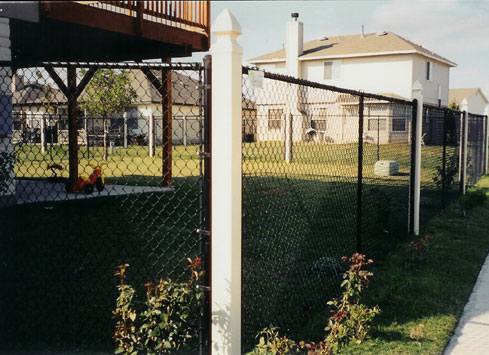 black chain link fence with white posts