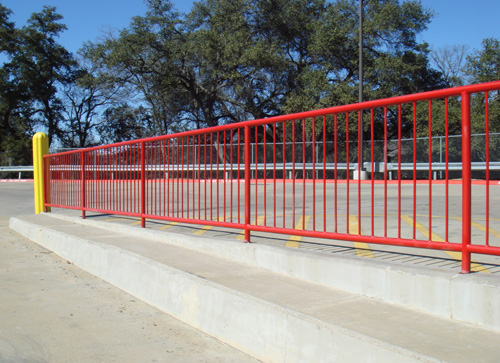 bright red handrail in parking lot