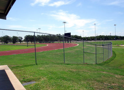 chain link fence around track