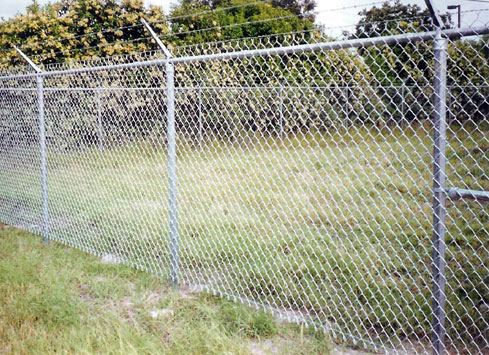 chain link security fence with barbed wire