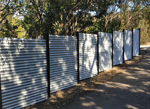corrugated tin metal fence around property and backyard