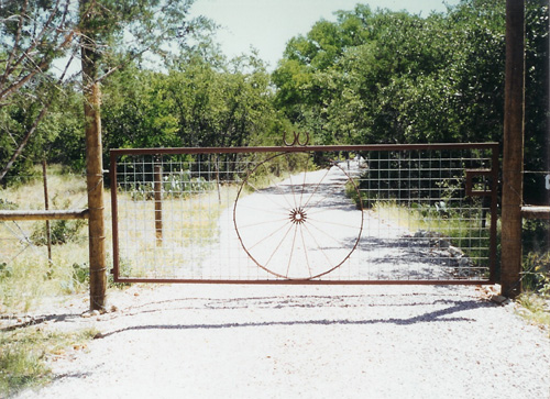 custom wagon wheel gate entrance to ranch