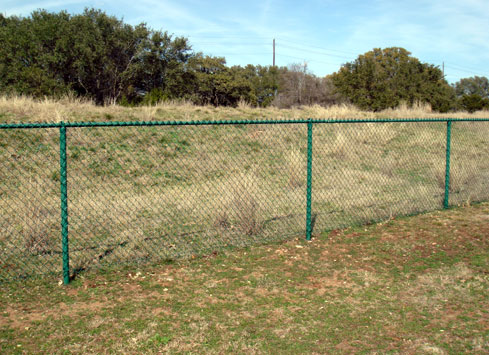 green chain link fence around property