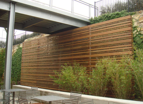 horizontal-stained-fence-under-walkway-bridge