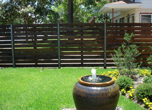 horizontal stained wood fence with metal posts