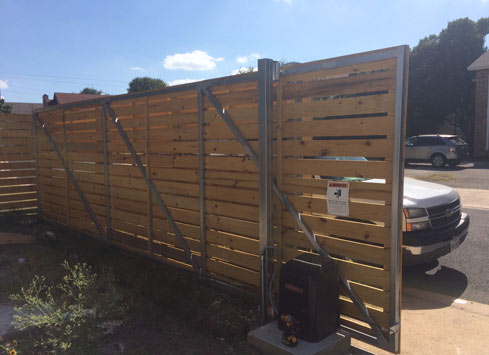 horizontal wood fence and gate with steel tube frame
