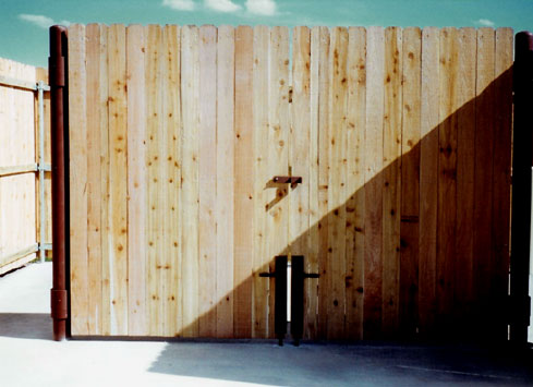 large swinging wood gate