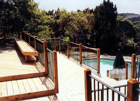 metal handrail wooden deck posts off pool