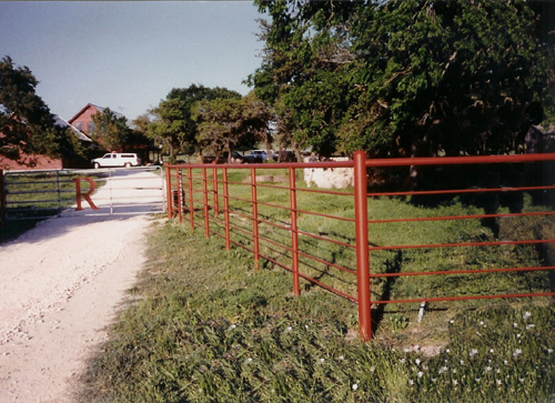 red painted steel ranch fence entrance