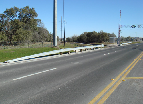 road guardrail at rail road crossing