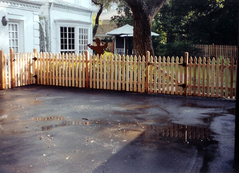 short fence around driveway with gate
