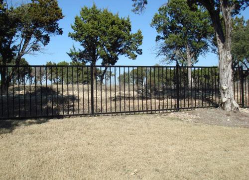 smooth black metal fence around property