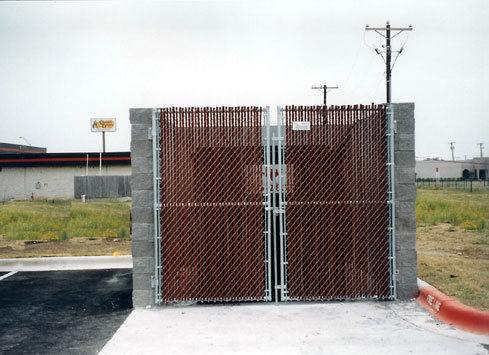 swinging chain link gate with screen dumpster garbage bin