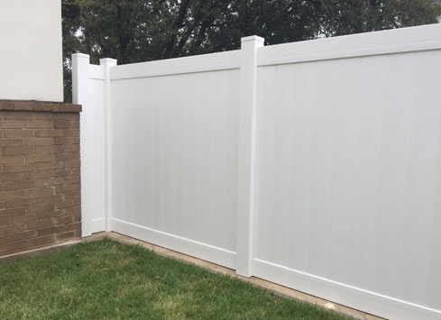 white backyard fence
