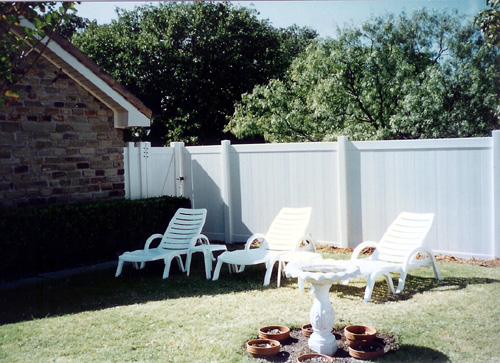 white fence around backyard