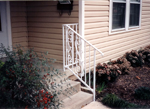 white handrail front steps of house 2