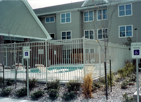 white metal fence around apartment pool