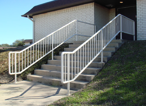white metal handrail going down steps