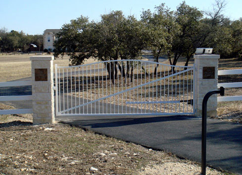 white metal swing out driveway gate solar powered front view
