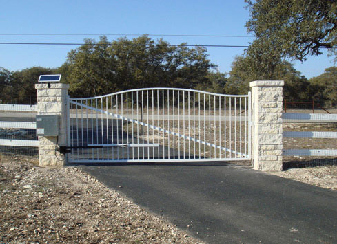 white metal swing out driveway gate solar powered