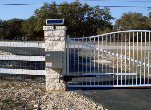 white metal swing out driveway gate