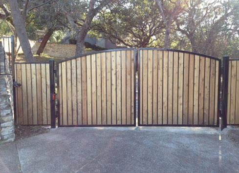 wood panel metal frame driveway gate