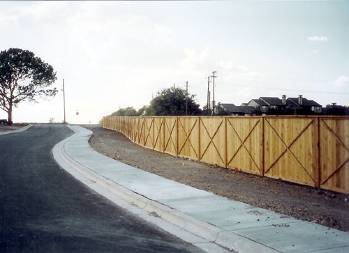 wood privacy fence around parking lot