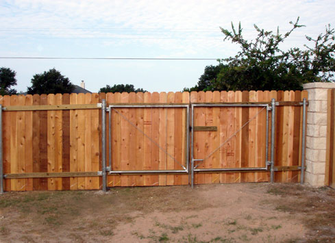 wood privacy fence with large gate