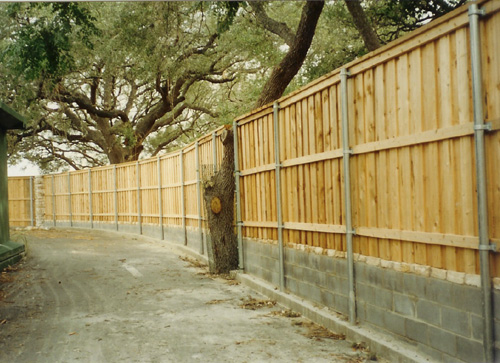 wood security fence metal posts concrete block wall