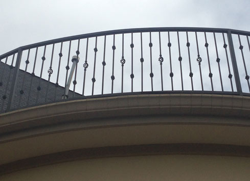 wrought iron handrail on second floor balcony