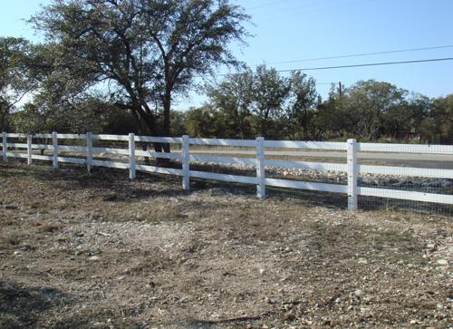 3 rail white fence around ranch