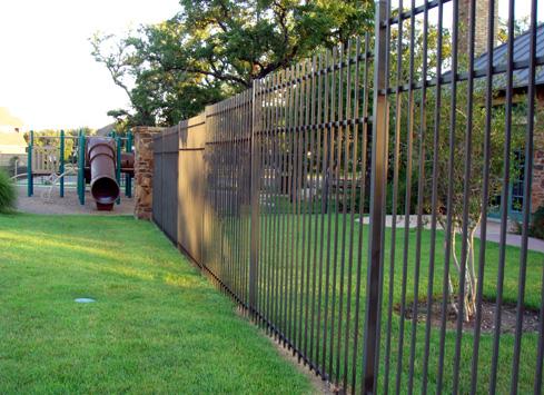 brown metal fence around playground