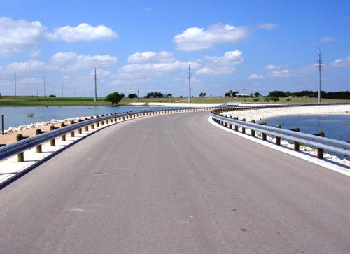 guardrail bridge across lake drive