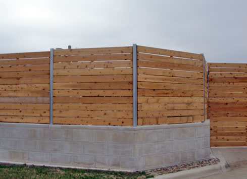 horizontal-wood-fence-with-metal-posts-on-top-of-concrete-base