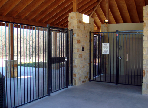 metal fence and security gate around pool